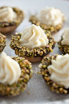 cannoli bites - these are mini cannoli baked in mini muffin tins and filled with cannoli filling (delicious dipped in chocolate and coated with pistachios).