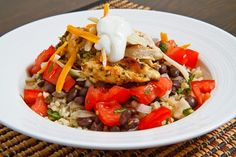 Burrito Bowl. 1 cup cilantro lime rice (warm, I used brown rice) 1/2 cup seasoned black beans 1/2 cup pico de gallo 1 tequila lime grilled chicken breast (sliced and divided) 1/4 cup jack and cheddar cheese (shredded) 2 tablespoons sour cream (optional) 1 handful cilantro (chopped)