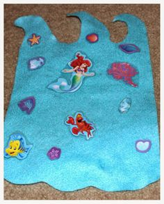 Hoyby Crafts-transform stickers to make them reuseable and perfect for on-the-go activities http://hoybycrafts.blogspot.com #littlemermaid #reuseablestickers