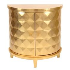 """Add a chic touch of style to your home with this eye-catching design, artfully crafted for lasting appeal.     Product: Console table    Construction Material: Wood and wood veneer    Color: Gold leaf   Features:  Modern style    Old Hollywood-inspired design showcases a demilune silhouette    Will enhance any décor   Dimensions: 32"""" H x 31.5"""" W x 15.5"""" D"""
