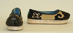 Title: Shoes/ Slippers Date: 1860–1944  Culture: Chinese minority (Manchu)  Medium: silk, cotton, metal, leather Dimensions: Length: 9 1/2 in. (24.1 cm)