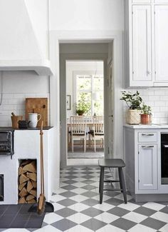 This is something I would love to have on my summer house - rustic cottage kitchen with checked floor and a woodburning cooker stove Modern Kitchen Cabinets, Kitchen Flooring, Rustic Kitchen, Country Kitchen, Kitchen Decor, Kitchen Ideas, Swedish Kitchen, Kitchen Tips, Cottage Kitchens
