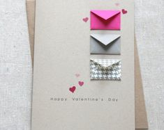 Card Size: 5 x 7 Envelope: A7 100% recycled kraft brown envelope Paper: Cards printed on 80# 100% recycled white fiber card stock.  Features 8 tiny envelopes with 7 blank cards tucked inside for writing your own messages. 1 translucent envelope contain little red confetti hearts. Front: SENDING YOU SOME {heart} Inside: Blank