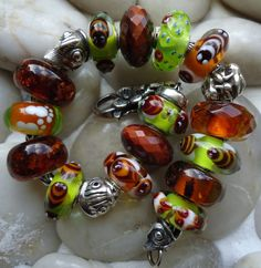 Critters and amber and stones.  From a great collector on Trollbeads Gallery Forum.