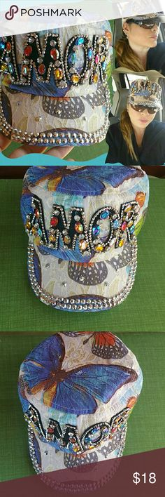 Awesome rhinestone baseball cap. Amaizing colorful rhinestone baseball cap,Amor word,butterfly print ,some beige lace,sme gold tones,silver and colorful faux stones,light ..no hot,ideal for use all year!Just beautiful! . One size adjustable. Most beautiful on person. New! Accessories Hats