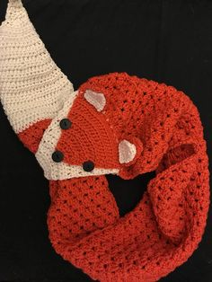 Crochet fox scarf that loops through the fox's mouth.