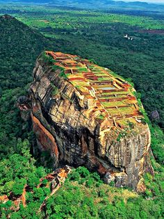 Sigiriya ,Sri Lanka: King Kasyapa (477 – 495 AD) built his palace on the top of this rock and decorated its sides with colourful frescoes. On a small plateau about halfway up the side of this rock he built a gateway in the form of an enormous lion. It is one of the best preserved examples of ancient urban planning. A UNESCO World Heritage Site.
