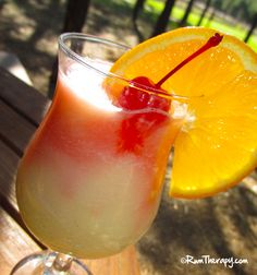 Island Delight   (2 oz. Coconut Rum  2 oz. Piña Colada Mix  2 oz. Orange Juice  .5 oz. Grenadine  Orange slice)