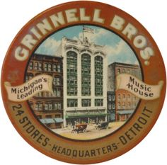 "Celluloid pocket mirror for the Grinnell Bros. advertised as Michigan's Leading Music House with 24 Stores and a Detroit Headquarters. Center of mirror features a colorized photograph of the headquarters building with antique autos in front. Text is nicely set with metallic accents. Silvering is crazed and flaking off of mirror on reverse. Edge marked American Art Works Coshocton O. size: 2-1/8"" dia."