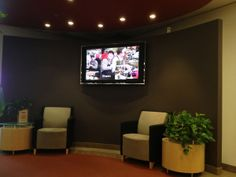 TV installed in an office by the lobby. It displays picture slideshows of companies achievements and current promotions. Hide Cables, Hide Wires, Tv Wall Mount Bracket, Wall Mounted Tv, Tv Wall Mount Installation, Separating Rooms, Wire Management, Concrete Slab, Plaster Walls