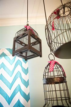 Birdcages. There is no end to what you can do with vintage birdcages — display them atop a high cabinet, fill them with twinkle lights, slip old photographs between the bars, paint them or suspend them from the ceiling .
