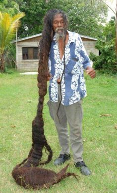 This man's hair is so long, you can see the gradation of graying hair at the scalp to no gray at the ends.