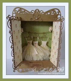 So I thought it would be totally neat to make a small French ballet cabinet for the ballet tutus. Recently Spellbinders has released some fantastic new dies and I used these to make this cabinet, including the cabinet doors. Why don't you go and check out the new dies @ My Crafty Heart, I ordered them as soon as I saw them! I made the dresses with the beautiful Melissa Frances Ribbons.