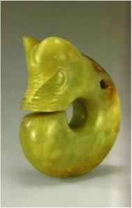 """*""""Pig Dragon"""" *Jade *Hongshan Culture *4700-2900. Jade coiled dragon H 10.3 cm. Hongshan Culture (c. 4700-2920 B.C.)  From Tomb 4 (Mound 1, Locality 1) at Niuheliang, Jianping, Liaoning Province Excavated in 1984 Liaoning Provincial Institute of Archaeology, Shenyang"""