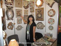 Marina Alexandrova with her seashell art works gallery.
