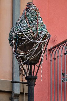 New Orleans Mardi Gras Beads   Mardi Gras beads on a lamppost in the French Quarter of New Orleans, Louisiana.