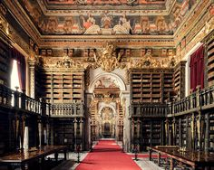 Biblioteca Joanina (The Joanina Library) is located in the historic city of Coimbra, Portugal. Founded by King John V in the century, as a part of the University of Coimbra, it holds over volumes 📷 Thibaud Poirier Modern Library, Library Design, Arquitectura Wallpaper, Library University, Old Libraries, Bookstores, Beautiful Library, Dream Library, Rio De Janeiro