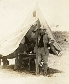 Photo taken in 1898, and shows Teddy Roosevelt as a Rough Rider. The photograph was taken in Florida, so the group would have been getting ready to go to Cuba for the Spanish American War.
