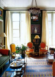 With pops of color and a linear patterned rug this classic room exudes elegance and fun #colorconfidence