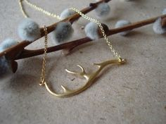 .dainty antler in gold - necklace 24.00