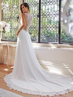 Love the lace back!! not sure about the long train and deep v neck front. Simple A-Line/Princess Sleeveless V-neck Ruffles Court Train Wedding Dresses 10989561 - Simple Wedding Dresses - bridalup.Com