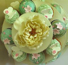 Top View of butterfly/flower cakes. by kylie lambert (Le Cupcake), via Flickr