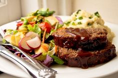 Honey Barbecue Meatloaf Recipe - The best, moistest, most crowd-pleasing meatloaf EVER. Tried and true and kid friendly!