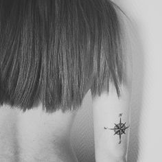 Love this...small compass tattoo but on my rib cage