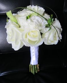 Bridal bouquet with roses and lisianthus; design by Davis Floral Creations