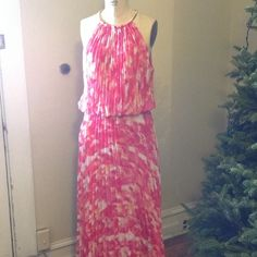 Floor length pleated dress This timeless classic is sure to be a hit, shades of pink, fuchsia and ivory are adorning this floor length pleated dress with an elastic waist and gold metal halter, ( adjustable ) This gown is new without tags. MSK Dresses Strapless