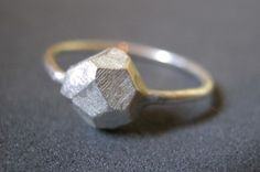 Faceted silver rock ring-- no, really, that's a helluva rock. TOTALLY unique! 25 Unconventional + Affordable Engagement Rings via Brit + Co.