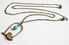 bird necklace, bird cage necklace, bird jewelry, turquoise necklace, bird cage jewelry, bird charm necklace, animal necklace, long necklace. $16.00, via Etsy.