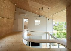 The roof of this Japanese home has been designed to hang like a shawl, drooping over the house to cover a terrace, tea room and carport.