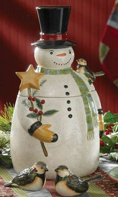 Winter Magic Cookie Jar, by Park Designs. The Winter Magic Collection features snowman artwork by Susan Winget, in a color palette of reds, winter blues, and light greens. This is for the Snowman-shaped Cookie Jar. Measures 13 inches. Made of ceramic. Other coordinating items also available!
