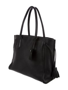 In Stores Now. Black leather Longchamp Penelope tote with gold-tone hardware, dual rolled shoulder straps, dual expandable drawstrings at sides featuring tassel details, tonal jacquard lining, three interior pockets; one with zip closure and zip closure at top. Includes dust bag. Shop Longchamp consignment handbags at The RealReal.