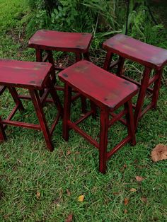 Barstools painted in a barn red color and distressed and dark waxed..