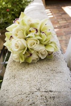 Green orchid & cream rose bouquet