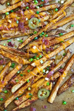 Guiltless cheesy baked seasoned fries topped with bacon, jalapeños and scallions... this is SOOO good! Pure comfort food when cheese fries are what you