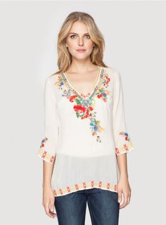 Miranda Blouse The Johnny Was Collection MIRANDA BLOUSE is a unique take on our signature embroidered blouse thanks to an eclectic embroidery design that combines geometric pattern and bold floral motifs. Pair this boho embroidered blouse with your favorite jeans to take your everyday look to the next level!  - Rayon - V-Neck and ¾ Sleeves - Signature Embroidery - Machine Wash Cold, Tumble Dry Low