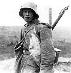 Classic image of WWI. Said to be a German soldier at the Battle of the Somme 1916