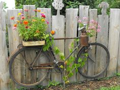 UP-CYCLED BIKE PLANTER: Don't throw it - grow in it! An old bicycle can be repurposed with micro container gardens and even used as a trellis for a climber like a grape vine. Mounted on a fence, you c (Diy Garden Art)