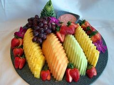 fruit tray from Costco. just rearrange on serving plateDiscover thousands of images about Rainbow fruit tray I made for baby showerFruit Tray, healthier than eating junk food!Modern Fruit Tray by Virginia Palmer Need to remember this way to display f Party Trays, Party Platters, Food Platters, Table Party, Party Food Buffet, Serving Platters, Fruit Party, Fruit Snacks, Fruit Recipes