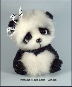 "ZinZin By Delane Summerwood - ZinZin is a black and white panda of approximately 4"" tall.He is created from faux fur and short pile Sassy fabric.He has premium black German glass eyes with an under eye white accent. Her nose is polymer clay with a tiny Swarovski crystal embedded in the clay for a bit of bling. ..."
