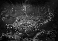 Shiva gana playing mridangam