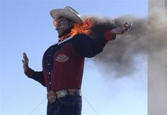 "Stunned attendees at the State Fair of Texas witnessed the iconic Big Tex go up in flames Friday morning.Follow @NBCNewsUSSome fabric that made up the towering structure's hand and sleeves could still be seen as firefighters gathered around the scorched area.Big Tex's 75-gallon hat, 50-pound belt buckle and slow drawl -- ""Howdy, folks!"" -- have been greeting fair visitors since 1952. This year's fair, which closes Sunday, had been celebrating Big Tex's 60th birthday.""It's a great loss for…"