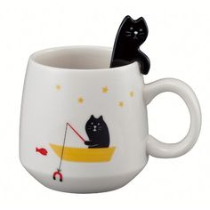 tea cup with cat spoon