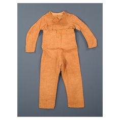 Boys suit. 1805-7. Belonged to John Stanton Yeomans. Boy's skeleton suit of brown and madder-red printed cotton in a dot and grid design. Connecticut historical society