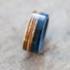 These are handmade wooden wedding rings made out of broken skateboards. As a skateboard, it contains colorful layers of canadian maple. The rings are prepared with special method that makes them waterproof. Price for a pair of wedding rings. You can ask about a particular color, we will check it in our workshop and send you some proposition! Every size is available! If you have any questions, or want a custom wedding rings made, let us know! We will try to create something together