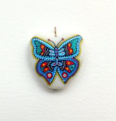 Colgante de mariposa piedra pintada mano por ISassiDellAdriatico