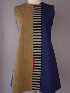 This vest has a hand woven striped band to accent the chevron quilted mustard with the cobalt blue.- Juanita Girardin